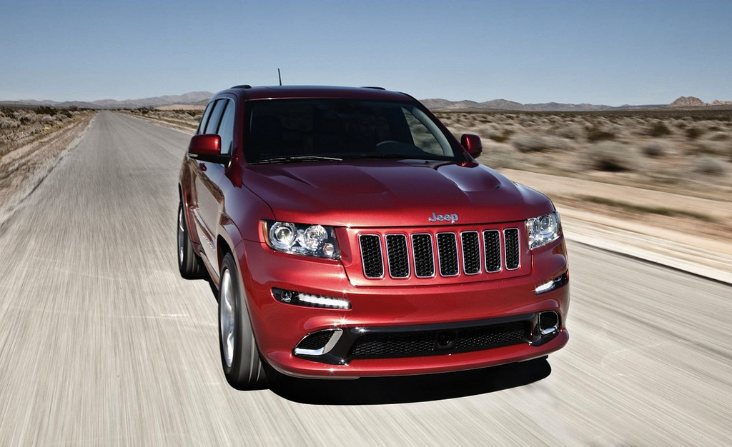 2012 jeep grand cherokee srt8 front 3 4 view action. Cars Review. Best American Auto & Cars Review