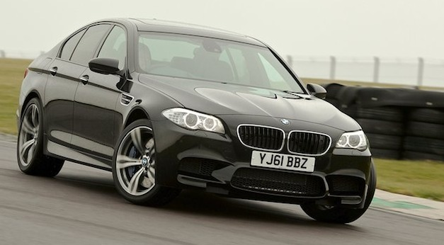 Video: 2012 BMW M5 goes drifting on the beach