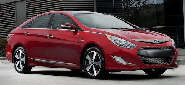 hyundaisonatahybridred Report: Hyundai, Kia sued by Toyota in patent fight over hybrid engine tech