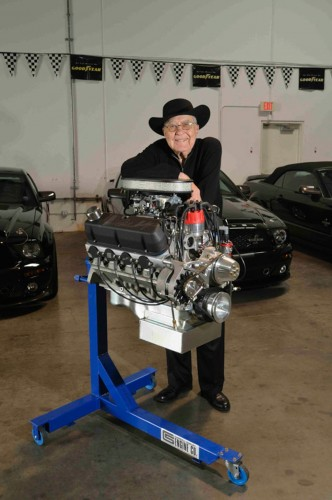 Carroll Shelby next to crate motor