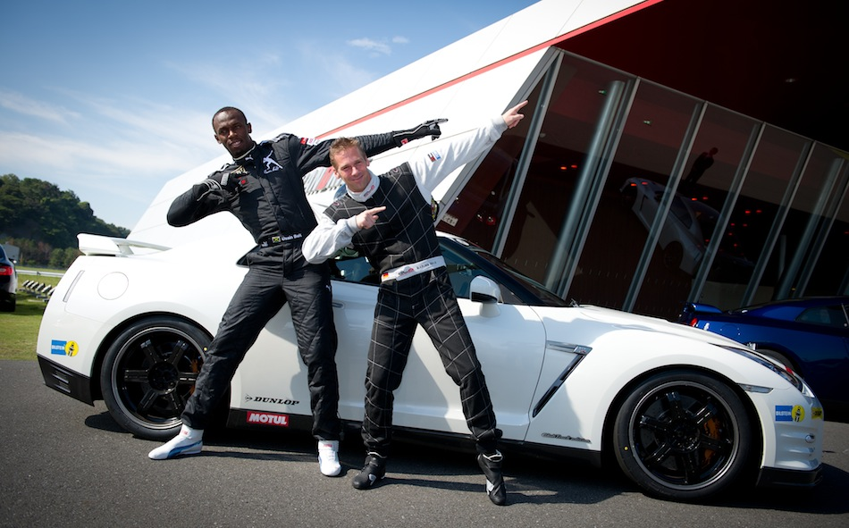 Striking a pose: Usain Bolt with Super GT driver Michael Krumm