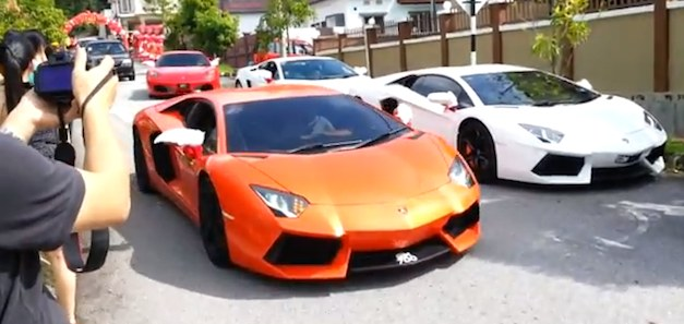 Malaysian athletes tie the knot with a parade of supercars