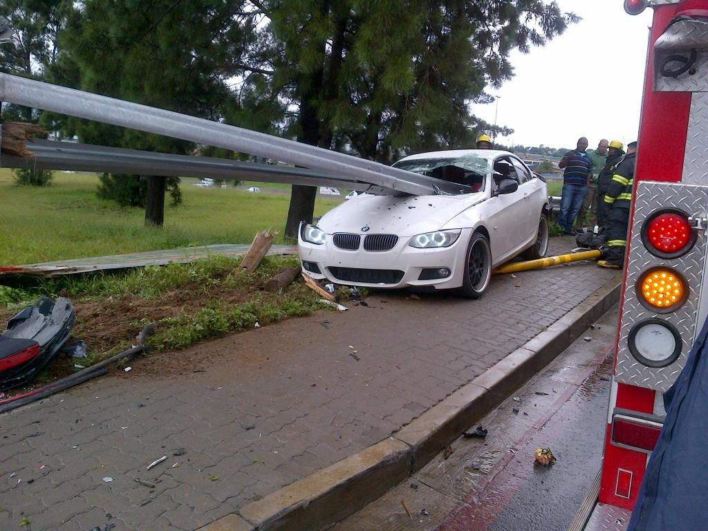 BMW 335i with a guardrail in it